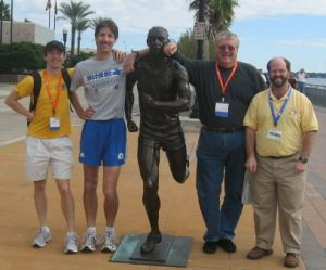 NE Delegates Dave Cahill, Steve Vaitones, Lance Turley and Pat Lavelle pose with the 'River Runner' in Jacksonville at the USATF Annual Meeting (Marja Bakker photo)